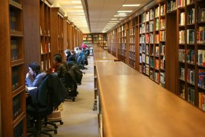 People at desks in a library
